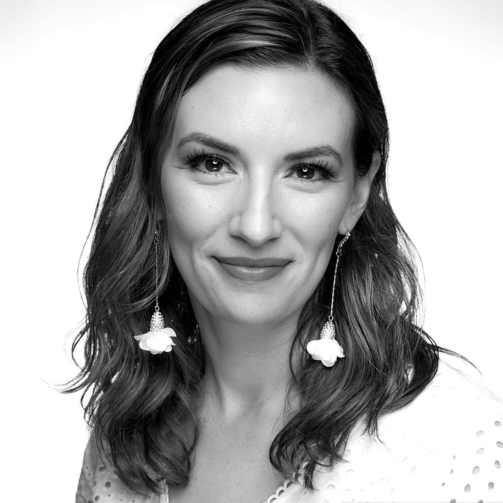 Black and white headshot of Inspired Studio President Maria Traino