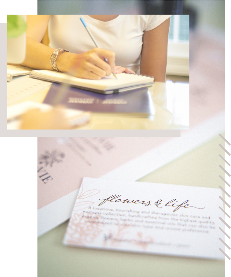 business card graphic design overlaid with woman writing on sketchpad to represent stages of branding process