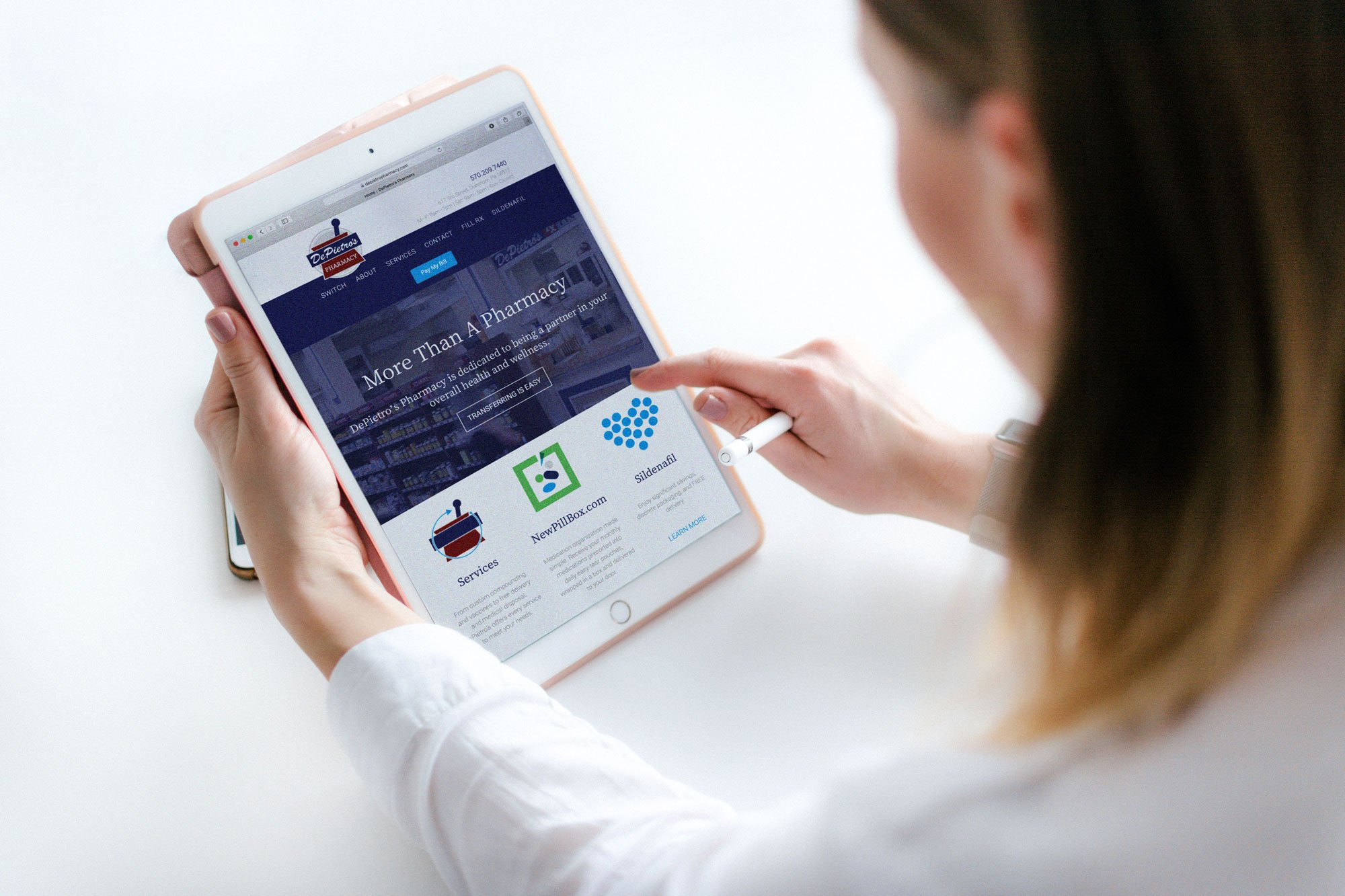 woman interacting with mobile website design for depietro's pharmacy